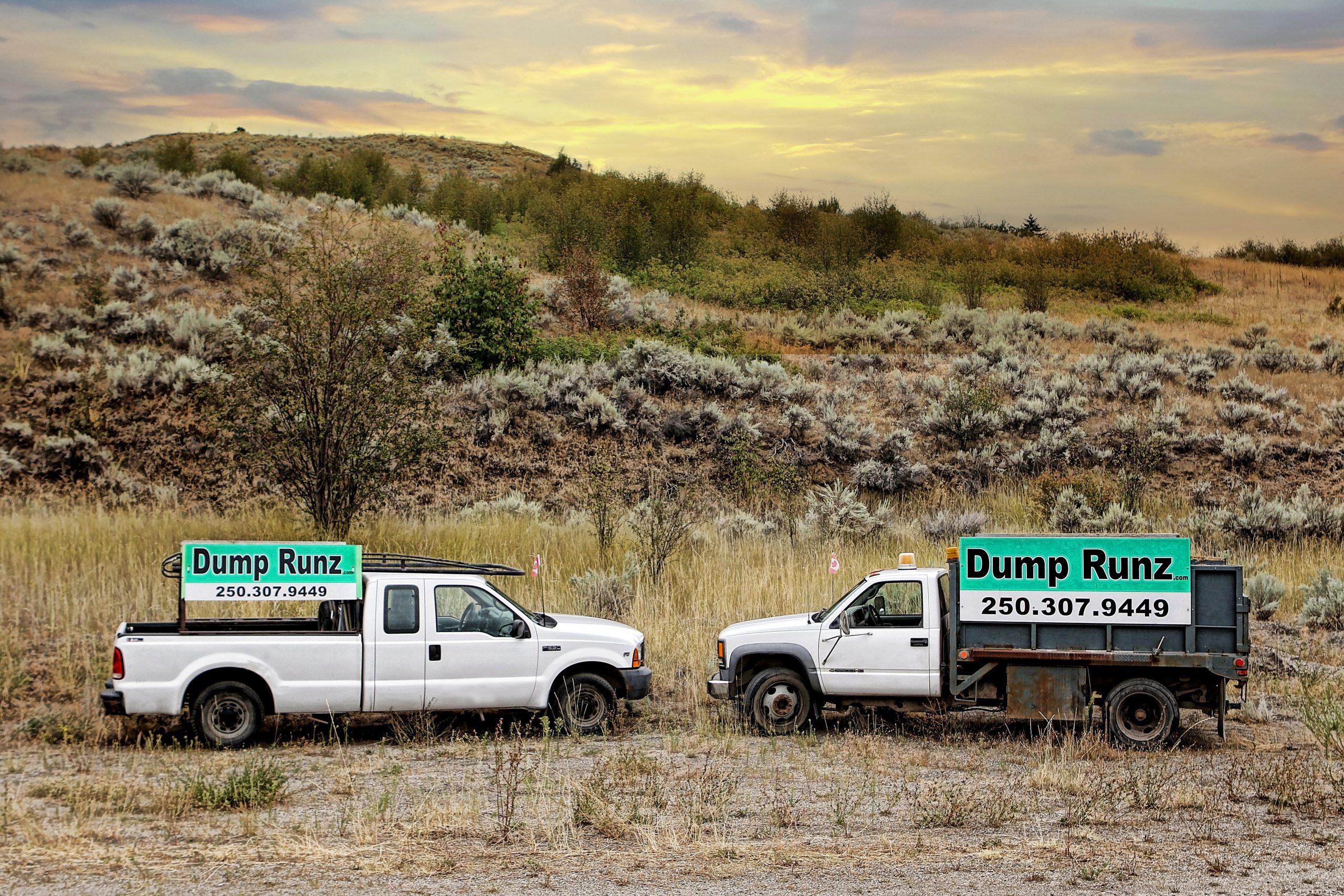 Dump Runz Trucks against the Hillside Vernon Dump Runz